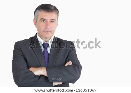Serious businessman with arms crossed