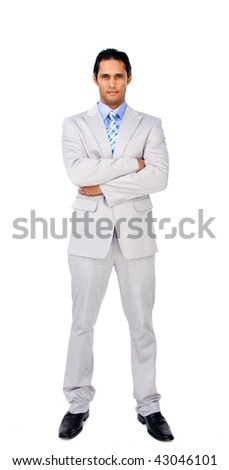Serious businessman with folded arms against a white background - stock photo