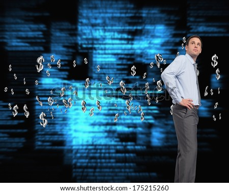 Serious businessman with hand on hip against blue blurred texts