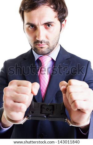 Serious businessman with shackles on his hands, isolated on white. Conceptual image. - stock photo