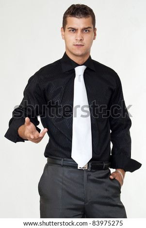 Serious businessman with stretched hand - stock photo