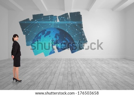 Serious businesswoman against display on wall showing global graphic - stock photo