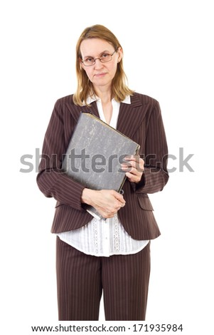 Serious businesswoman holding ring binder with old documents - stock photo