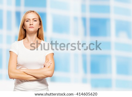 Serious businesswoman on the background of glass office building. Young sad female outdoors - stock photo