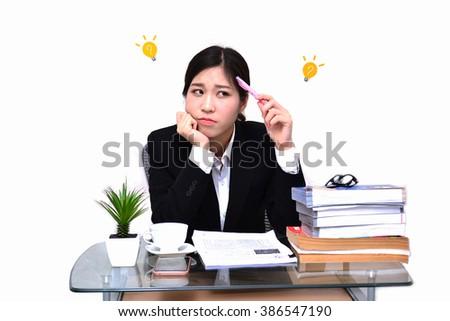Serious businesswoman on white background focus on face - stock photo