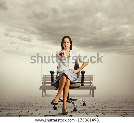serious businesswoman sitting on the office chair at outdoor