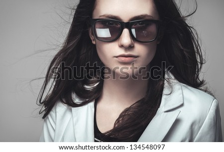 serious businesswoman staring through sunglasses