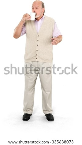 Serious Caucasian elderly man with short grey hair in casual outfit using mug cup - Isolated