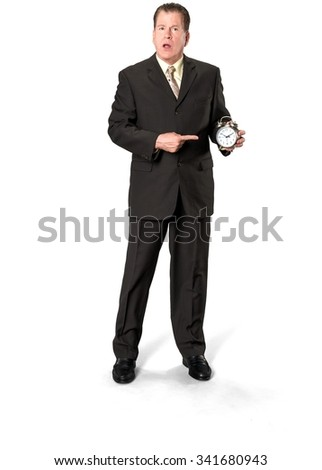 Serious Caucasian elderly man with short medium brown hair in business formal outfit holding alarm clock - Isolated