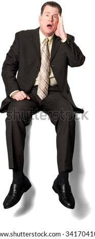 Serious Caucasian elderly man with short medium brown hair in business formal outfit with hands on thighs - Isolated - stock photo