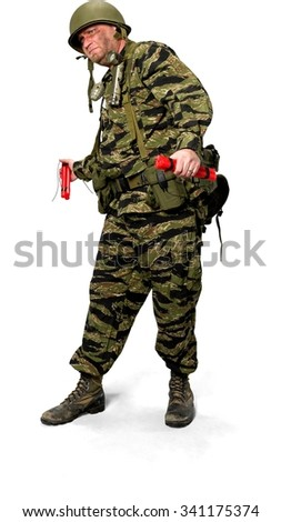 Serious Caucasian man in uniform holding bomb - Isolated - stock photo