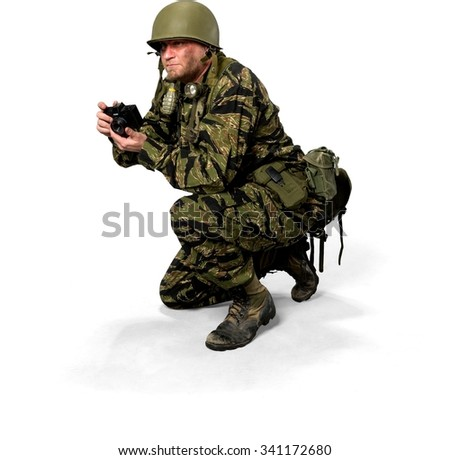 Serious Caucasian man in uniform holding camera - Isolated - stock photo