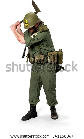 Serious Caucasian man in uniform using shovel - Isolated