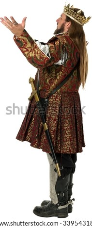 Serious Caucasian man with long medium brown hair in costume with arms open - Isolated - stock photo