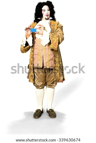 Serious Caucasian man with medium black hair in costume holding business card - Isolated - stock photo