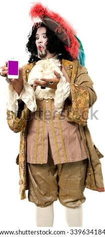 Serious Caucasian man with medium black hair in costume holding mobile phone - Isolated - stock photo