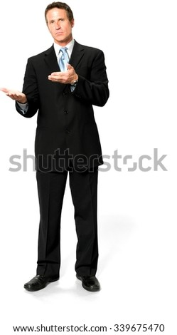 Serious Caucasian man with short black hair in business formal outfit holding invisible object - Isolated - stock photo