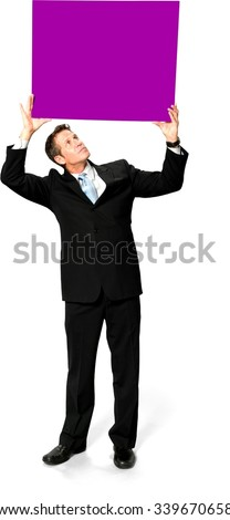 Serious Caucasian man with short black hair in business formal outfit holding large sign - Isolated - stock photo