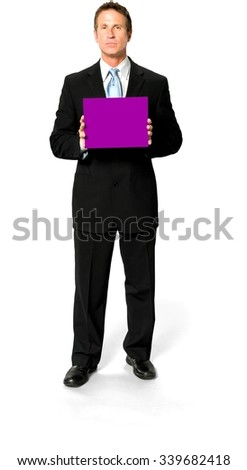 Serious Caucasian man with short black hair in business formal outfit holding medium sign - Isolated - stock photo