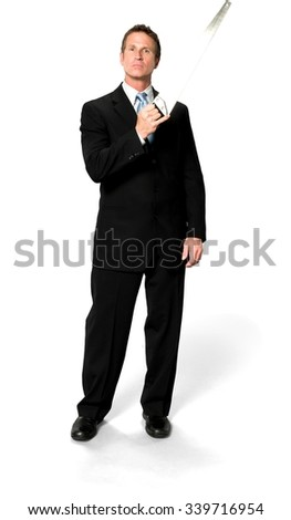 Serious Caucasian man with short black hair in business formal outfit holding saw - Isolated - stock photo