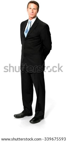 Serious Caucasian man with short black hair in business formal outfit with hands behind back - Isolated