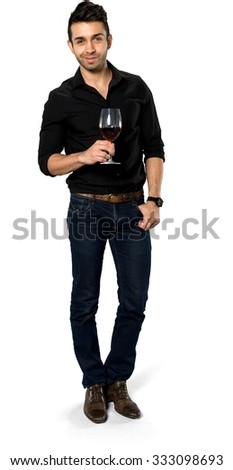 Serious Caucasian man with short black hair in casual outfit holding wine glass - Isolated