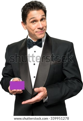 Serious Caucasian man with short black hair in evening outfit holding business card - Isolated - stock photo