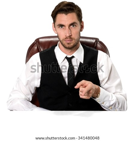 Serious Caucasian man with short dark brown hair in business casual outfit pointing using finger - Isolated - stock photo
