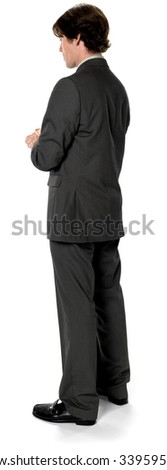 Serious Caucasian man with short dark brown hair in business formal outfit with clasped hands - Isolated