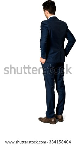 Serious Caucasian man with short dark brown hair in business formal outfit with hands in pockets - Isolated