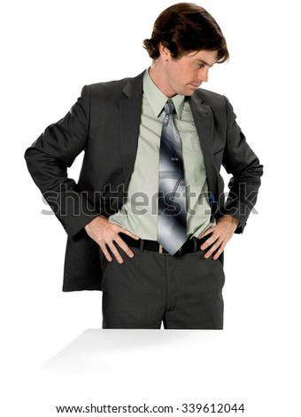 Serious Caucasian man with short dark brown hair in business formal outfit with hands on hips - Isolated
