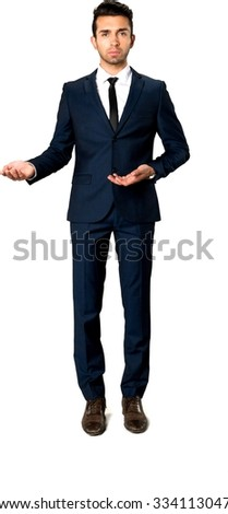 Serious Caucasian man with short dark brown hair in business formal outfit with hands open - Isolated