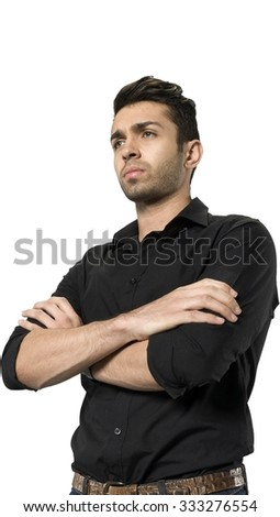 Serious Caucasian man with short dark brown hair in casual outfit holding arm - Isolated