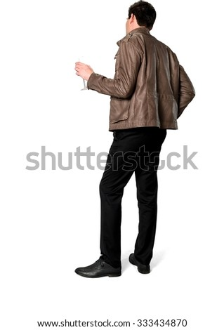 Serious Caucasian man with short dark brown hair in casual outfit holding champagne glass - Isolated - stock photo