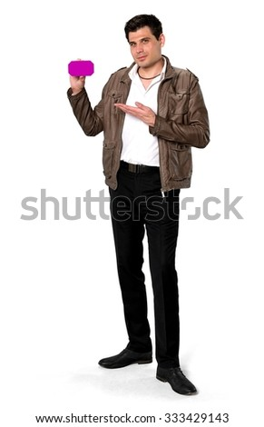 Serious Caucasian man with short dark brown hair in casual outfit holding phone placeholder - Isolated