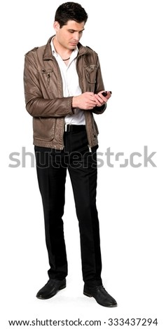 Serious Caucasian man with short dark brown hair in casual outfit using mobile phone - Isolated - stock photo