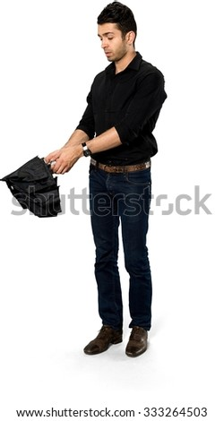 Serious Caucasian man with short dark brown hair in casual outfit using umbrella - Isolated
