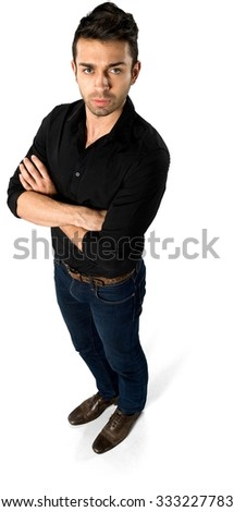 Serious Caucasian man with short dark brown hair in casual outfit with arms folded - Isolated