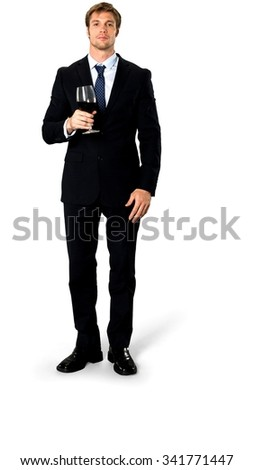 Serious Caucasian man with short medium blond hair in business formal outfit holding wine glass - Isolated