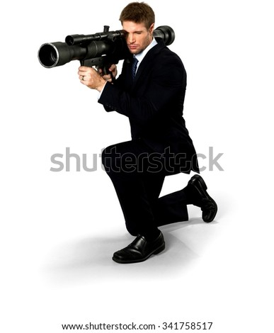 Serious Caucasian man with short medium blond hair in business formal outfit using bazooka - Isolated