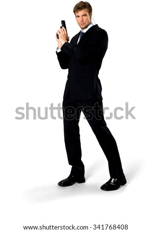 Serious Caucasian man with short medium blond hair in business formal outfit using handgun - Isolated - stock photo