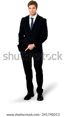 Serious Caucasian man with short medium blond hair in business formal outfit with hands in pockets - Isolated