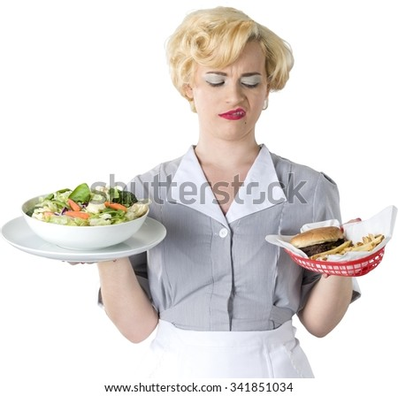 Serious Caucasian woman with short light blond hair in uniform holding food - Isolated