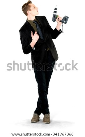 Serious Caucasian young man with short light blond hair in business formal outfit holding power tool - Isolated