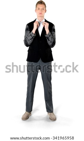 Serious Caucasian young man with short light blond hair in evening outfit holding prop - Isolated