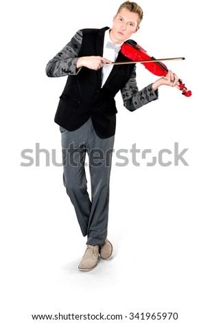 Serious Caucasian young man with short light blond hair in evening outfit using musical instrument - Isolated