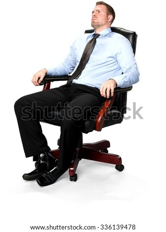 Serious Caucasian young man with short medium brown hair in business formal outfit sitting in chair - Isolated - stock photo