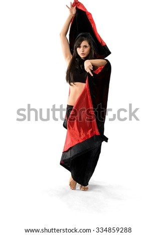 Serious Caucasian young woman with long dark brown hair in costume dancing - Isolated