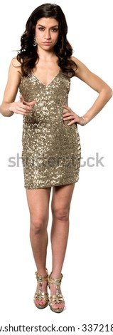 Serious Caucasian young woman with long dark brown hair in evening outfit with hands on hips - Isolated