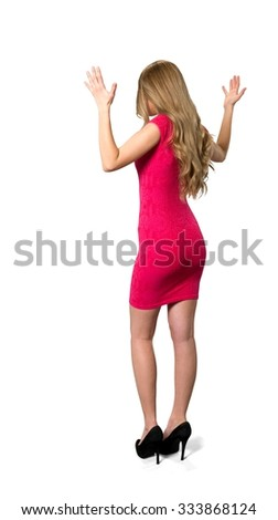 Serious Caucasian young woman with long light blond hair in evening outfit talking with hands - Isolated